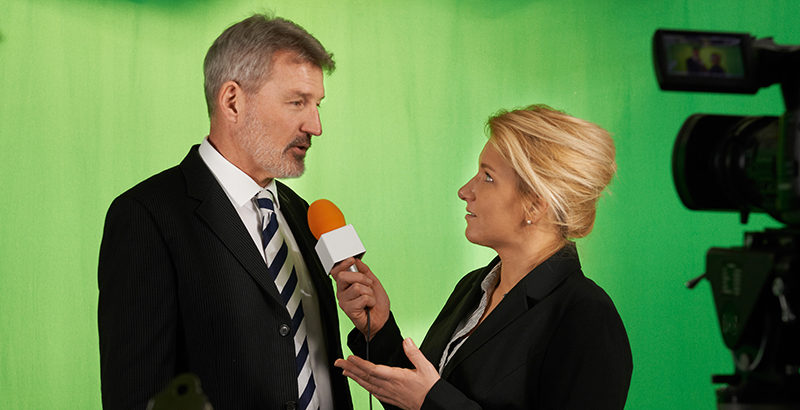 Interviewer and businessman on green screen