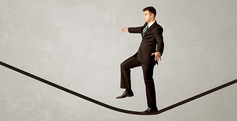 businessman on tightrope